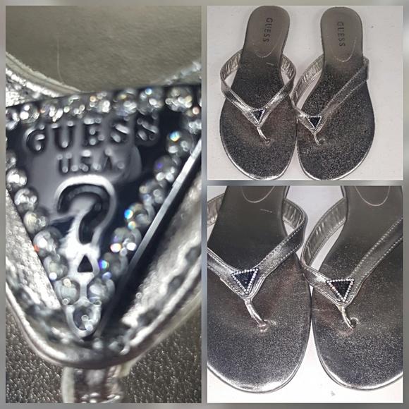 a016d74895aa Guess Shoes - Guess bronze metallic logo rhinestone flip flops